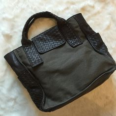 """BCBG Olive & Brown Leather Tote Leather weaved details on an olive canvas. Tons of pockets inside. Inner long middle zip pocket. Fits a 13-15.5"""" laptop comfortably. Tore style, no long strap. BCBGMaxAzria Bags Totes"""