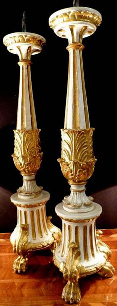 Pair of fine, Italian, Neoclassical period, painted and parcel-gilded pique cierges (candlesticks): Last quarter of the 18th century.