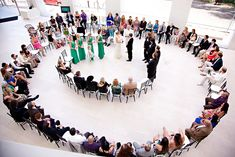 "We've seen some weddings in the round before, but Jenni and Shaun's ""spiral aisle"" is pretty genius."