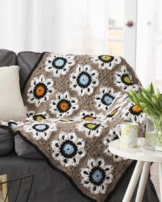 Traditional flowers in a modern color palette bring out the best in this eye-grabbing afghan ~ free crochet pattern