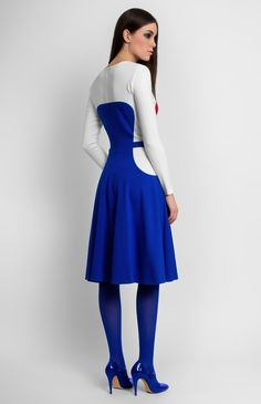 Long-sleeve knitted dress with inset side pockets. Round neck. Hidden back zip closure.