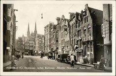 """1940's. View on the Spuistraat in the direction of Het Spui in Amsterdam. On the right De Vliegendesteeg with on the corner the restaurant """"Moeder Hendrina' Anno 1627. In the background the towers of the Kreitberg of Sint Franciscus Xavierkerk. In the center the tracks of the Blauwe Tram serving Haarlem/Zandvoort. Photo Hema. #amsterdam #1940 #Spuistraat"""