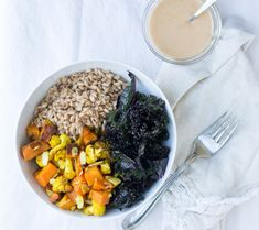 A vegan cleansing grain bowl with cauliflower, sweet potatoes and kale. Served with miso tahini sauce.   becausefoodislife.com