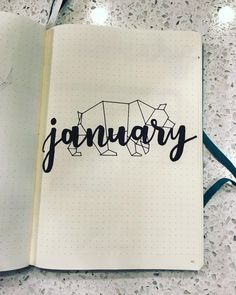 Bullet journal monthly cover page, January cover page, geometric animal drawing. | @hannah.snell.art