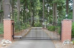 Single swing gate with posts wrapped in brick masonry #driveway #security #beauty #automated #electric #custom #iron #entrance #swing #simple #pillars #columns