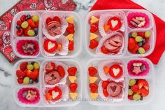 Salami with hearts cut out, cheese hearts, tomato hearts, grapes, strawberries, and yogurt covered cookies.