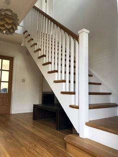 An oak, cut-string staircase featuring a pear oak handrail. Our customer chose to leave the treads and handrail in their natural oak colour, whilst priming all other parts white. Oak Stairs, Attic Stairs, House Stairs, Staircase Makeover, Staircase Ideas, Staircase Design, White Staircase, Curved Staircase, Oak Handrail