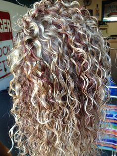 blonde curly hair with red streaks.. This is exactly what I want