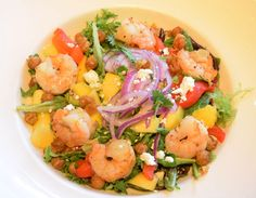 Wild Caught Shrimp Salad with crispy Moroccan chickpeas, mango, red onion and feta cheese, tossed with mixed greens and honey-lime vinaigrette | Green Valley Grill | Greensboro, NC