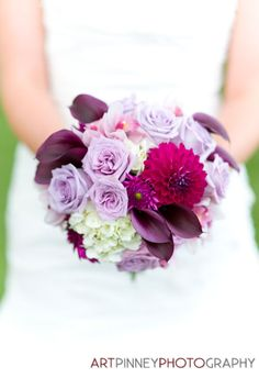 Purple and white bouquet of hydrangeas, dahlias, calla lilies, roses, asters and orchids