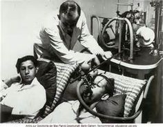 This is a picture of Josef Mengele experimenting on twins. He had an interest in experimenting with twins, and always looked for them at the Jewish transports.