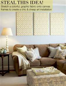 Make your own wall art with fabric and a canvas board or styrofoam board.