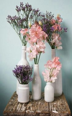 Simple floral arrangements for a rustic wedding in pink and purple (Bottle Centerpieces Purple)