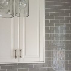 Teaser. Off white IKEA bodbyn. Glass tiles 2x6 in rain from south cypress.com #whitekitchen