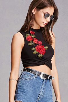 A soft knit crop top featuring a high neck, sleeveless cut, front rose applique, a twist-front design, and a form-fitting silhouette.<p>- This is an independent brand and not a Forever 21 branded item.</p>