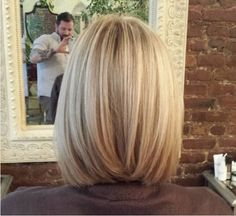A bob that nearly touches the collarbone in the front and is slightly shorter in the back, by about an inch. Then add light layering on top to add a little movement, and it will show off waves more when curled.