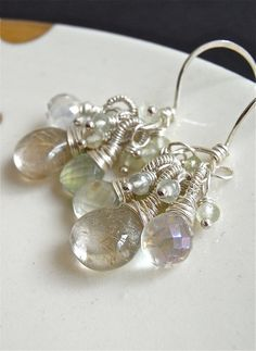 The Unfurling earrings - golden rutile quartz, rock crystal quartz, prehnite combine with bright sterling in this delicate design.