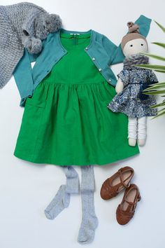 MayaAndMe - girls winter outfit, green dress, blue cardigan, scarf, stockings and brown Mary-Janes with matching doll
