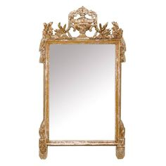 French Gilded and Ornately Carved Wood Mirror with Urn Motif Crest, Gold Color | From a unique collection of antique and modern wall mirrors at https://www.1stdibs.com/furniture/mirrors/wall-mirrors/