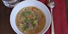 In this take on a classic Ecuadorian soup, beef and hearty brown rice are simmered until tender in a simple broth flavored with a refrito of onion, garlic and annatto.