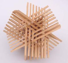 Geometric sculpture that has an ending. Each wooden piece is just a straight line but they are arranged in a way that intertwines them.