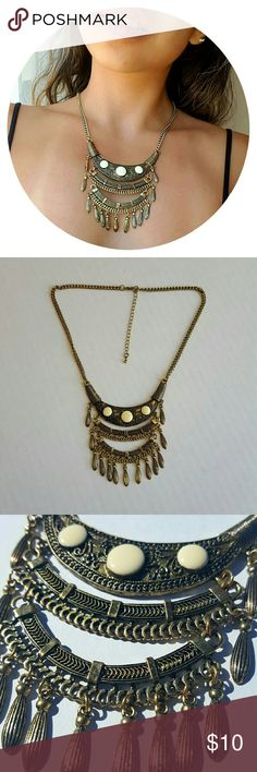 Bronze necklace Cute bronze colored necklace from Tilly's.  Worn a few times, light wear on the material. Very exotic and aztec - looking, perfect for a night out! ???? Tilly's Jewelry Necklaces