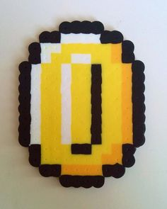Hey, I found this really awesome Etsy listing at https://www.etsy.com/listing/191569157/super-mario-bros-coin-perler-bead-art
