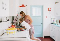 Mother baking with son in cute kitchen by KristinRogers | Stocksy United