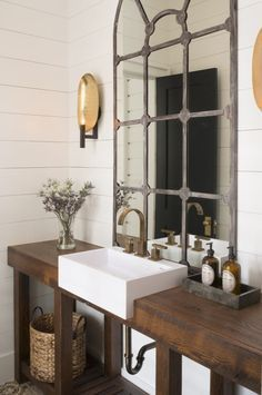 Country Powder Room with limestone tile floors, High ceiling, Wood counters, Powder room, Wall sconce, Farmhouse sink