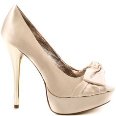 Simple elegance is yours with a twist when you slip into this new look from Luichiny. Knot me features a an ivory satin upper with knot detail at the vamp. This peep toe pump is complete with a gold metallic 4 1/2 inch heel and 1 inch platform.
