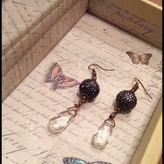Handmade earrings Handmade earrings with lavender filigree sphere and clear teardrop shaped stone. Two inches long Nameless Creations Jewelry Earrings