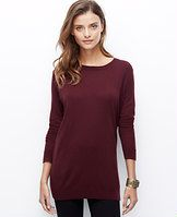 Side Zip Sweater - Zipped down - or up to reveal a favorite layering tee - this wool-infused piece is a perfect match for slim pants and leggings. Crew neck. Long sleeves. Exposed side zippers. Ribbed neckline, cuffs and hem.
