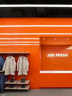 The Joe Fresh logo is illuminated behind a service counter. Toronto designer Diego Burdi, creative director and founding partner of Burdifilek, planned the clothing brand store to reflect its evolving identity, ensuring its core values translated into the industrial space. #InteriorDesign #RetailSpaces #DesignInspiration Commercial Interior Design, Commercial Interiors, Modern Interior, Showroom Design, Downtown Toronto, White Ceiling, Interior Design Magazine, Joe Fresh, Design Firms