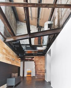 Original steel beams crisscross the vestibule at a 1920s warehouse in Dumbo, Brooklyn, that @markzeffdesign converted into his firm's creative studio. : Eric Laignel. #architecture #interior #design #interiordesign #brooklyn #dumbo #steel #studio #warehouse #office... - Interior Design Ideas, Interior Decor and Designs, Home Design Inspiration, Room Design Ideas, Interior Decorating, Furniture And Accessories