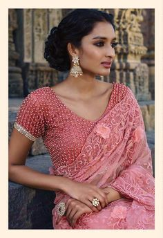 Peach saree in net fabric with thread work and stunning moti work blouse for the diva in you