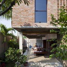 Vietnam house by MM++ Architects features a palm-leaf roof and an open-air living space Post Modern Architecture, Architecture Résidentielle, Tropical Architecture, Brick Facade, Facade House, Modern Exterior, Exterior Design, House On Stilts, Brick Design
