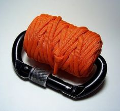 Paracord Carabiner Spool.Clip it to your bag and forget about it until you need it. - http://www.survivalacademy.co/