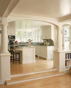 Like the idea of built-in shelves between kitchen and family room -- i can do this! White kitchen and breakfast room with fireplace and arches - traditional - kitchen - new york - by Huestis Tucker Architects, LLC Living Room And Kitchen Design, Living Room Designs, Kitchen Open Concept, Open Kitchen, Kitchen Windows, Kitchen Layout, Kitchen Ideas, Kitchen Designs, Nice Kitchen