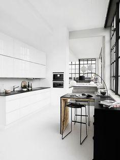 White kitchen, black dining room