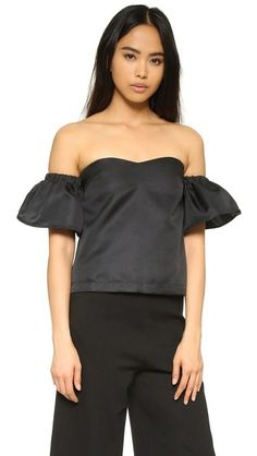 Black re:named  top off shoulder  for woman A strapless re:named top with a sweetheart neckline and a cropped profile. Hidden snaps detach the puffed short sleeves. Hidden back zip. Nonslip rubber binding at top hem. Lined. Fabric: Plain weave. 100% polyester. Dry clean. Imported, China. Measurements Length: 12.5in / 32cm, from center back Measurements from size S. Available sizes: L,M,S #tophombrosdescubiertos #offshoulders #tube #offtheshoulder #coldshoulder #bardot #cutout #bandeau