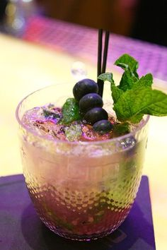 The Acai Mojito from Caesars Palace's NUMB Bar    6-8 blueberries  4-6 mint leaves  1 oz simple syrup  1 large lime half OR 2 small lime halves  1 oz Pitu Cachaca  1/2 oz Veev Acai Spirit  1 full scoop of ice    Muddle blueberries, mint leaves, and simple syrup  Shake all ingredients together  Pour  Fill with soda  Garnish with a blueberry spear
