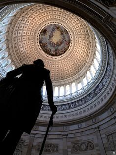 An image looking up from the statue of George Washington in the Rotunda of the U.S. Capitol Building, showing Constantino Brumidi's fresco, the Apotheosis of Washington ~ Washington, DC
