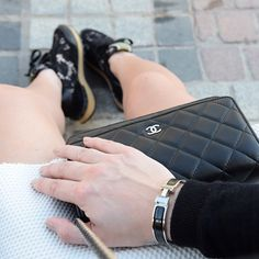 Hermes black clicclac bracelet, Chanel WOC wallet on chain black lambskin, Maison Valentino lace sneakers rockstuds by Yasmin_dxb instagram