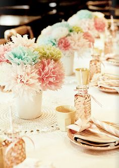 tissue paper bouquets in place of flowers. Perfect for a rehearsal dinner center piece.