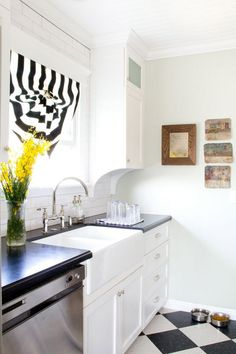 retro-style bungalow kitchen with checkerboard floor