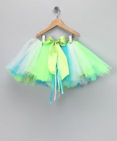 Made in the USA with the expertise of a fairy, this colorful tutu will take any mini ballerina's imagination to new heights. Plus, it has an elastic waistband for fluttery comfort and is machine washable to keep the pretty on this piece pristine.Fits ages 2 to 10 yearsPolyester / tulleMachine wash; hang dry