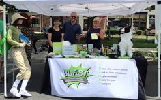 In keeping with its public awareness mission, the BLAST Lyme disease program had a booth at the July 18 Summerfest celebration on Main Street From left are the mannequin known as Tick Check Barbie, on loan for the day from the WestConn Tick Research Lab), and volunteers Jennifer Reid, Rich Braaten and Karen Gaudian. — Neeta Connally photo