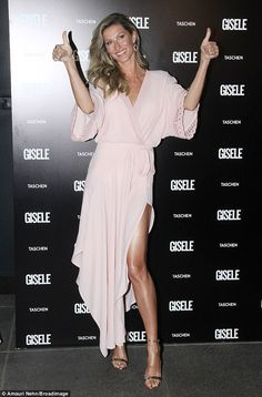 Thumbs up for style: Gisele Bundchen showcased her supermodel stems in a dusty pink thigh-split dress as she attended her book launch after-party in Sao Paulo, Brazil, on Friday evening