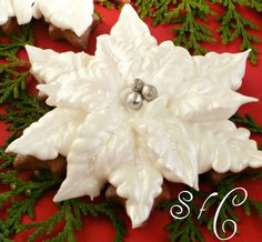 Luster Dusted White Royal Icing Poinsettia Cookie with Silver Dragees