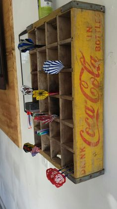 Antique Coke Crate used as Dart holder! So stinkin cute!!